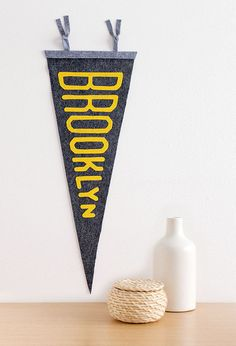 Show your city pride with a custom felt pennant. (You can even choose the colors!)