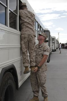 MARINE CORPS AIR GROUND COMBAT CENTER TWENTYNINE PALMS, Calif. -Friends of the Marines and sailors of Company L, 3rd Battalion, 4th Marine Regiment, find a unique way of saying goodbye to their friends shortly before the buses pull out April 6, 2011.Lance Cpl. Sarah Anderson, 4/6/2011 5:07 AM