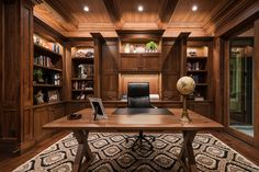 Home office featuring gorgeous wood and a beautiful organic print rug. Designed by luxury interior design firm, Lisman Studio!