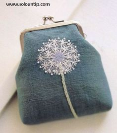 My great grandma always carried a coin purse, and gifted me with many. Totally using this dandelion embroidery pattern.
