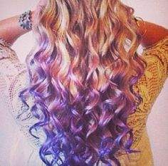 Curly blond hair and purple dyed ends