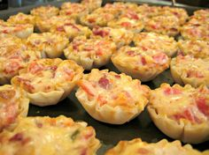Rotel Cups makes 45 cups. Ingred: 1 can Rotel tomatoes, drained; 1 bag bacon pcs; 1C shredded swiss; 1C mayo; 3 pkg phyllo pastry cups, thawed, and placed on a cookie sheet.  Pre-heat oven to 350; Mix tomatoes, bacon, swiss, and mayo and scoop evenly in cups. Bake @ 350 for 15min.