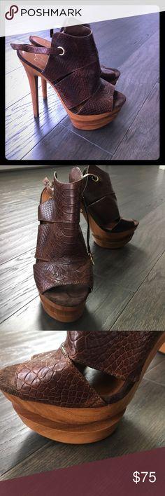 "Jessica Simpson Platform Sandal Chocolate brown reptile Jessica Simpson Sandal with wooden platform.   Heel measures 6.5"".  Ankle strap closure features gold buckle closure. Gently worn. Jessica Simpson Shoes Platforms"