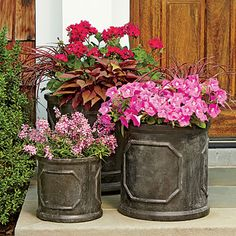 Pink Nature-Inspired Planters | The natural hues of the sweet potato vine and pennisetum make the trio of pink geraniums, petunias, and angelonias pop.