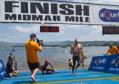 Troy Prinsloo challenges Chad Ho at the finish line at the 2014 Midmar Mile in one of the closest finishes Midmar has ever seen. Kwazulu Natal, Finish Line, Alexandria, Troy, South Africa, Basketball Court, Challenges, It Is Finished, Swimming