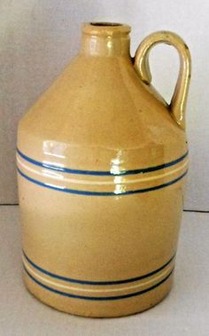 This is a good antique yelloware jug with blue and white bands. Item is in excellent condition with no chips, cracks etc. The mark you see on the handle is in the making and not damage. Very nice over