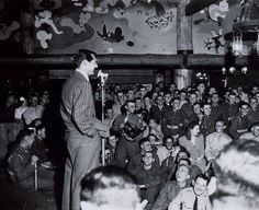 Cary Grant entertains the troops at the Hollywood Canteen. Description from pinterest.com. I searched for this on bing.com/images
