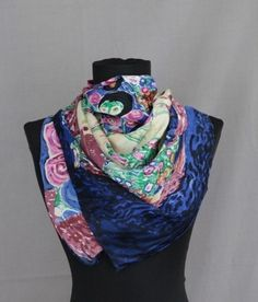 A beautiful 100% silk scarf depicting a woman with a floral scenery background in fantastic bright colours. Can be used as a neck scarf or a head scarf.