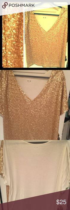 Three Dots gold sequin top The top that will turn heads! Leave a little sparkle everywhere in this glistening gold sequined tip from three dots.   The top is lined to keep things comfortable and is cream in back.   Only worn once! Three Dots Tops Blouses