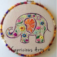 8 hoop, hand embroidered colorful garden elephant on canvas. Single and double thread embroidered. Done with a variety of threads & stitches. Wrapped in a beautiful silk yarn and finished off in the back with a pretty fabric and matching cording. Embroidery Needles, Hand Embroidery Stitches, Embroidery Hoop Art, Embroidery Techniques, Embroidery Applique, Cross Stitch Embroidery, Embroidery Patterns, Band Kunst, Needlework