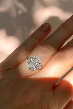 Antique Edwardian engagement ring featuring an approximately carat pear-shaped diamond. Accented with 12 single-cut diamonds in a filigree mount. Black Diamond Engagement, Pear Shaped Engagement Rings, Antique Engagement Rings, Halo Engagement, Filigree Engagement Ring, Designer Engagement Rings, Pear Shaped Diamond Ring, Diamond Solitaire Rings, Diamond Wedding Rings