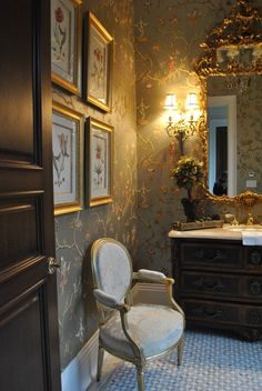 Very elegant powder room with chinnoiserie wallpaper and mirror, Louis VI chair and classic vanity chest.
