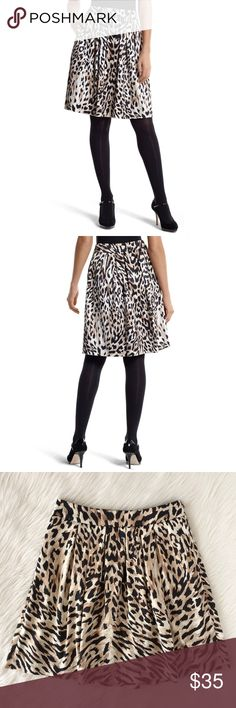{whbm} sateen leopard print skirt A good wardrobe revolves around great skirts like this. A pleated, A-line silhouette and soft, sateen leopard print make this a multi-season classic. Pair this beauty with a red lip and black heels and you'll be looking fierce and fabulous  ▫️Pristine Condition; No Signs of Wear  Features: ▫️Sits at the waist ▫️Open box pleats, flat waistband, hidden side zip with hook-and-eye closure ▫️98% Polyester, 2% Spandex ▫️ Machine wash cold  Measurements (Flat)…