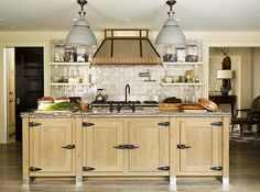 great wood cabinets with dark pulls and hinges!