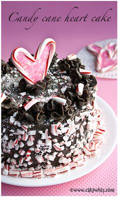 HOW TO MAKE A BOXED CAKE MIX TASTE MIND-BLOWING WITH MANY VARIATIONS! This has got to be the softest and moistest cake I have ever made, covered in luscious chocolate buttercream and covered in crushed candy canes and topped off with a candy cane heart. Perfect cake for Valentine's day! From cakewhiz.com