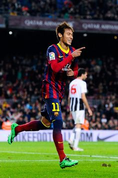 Neymar of FC Barcelona celebrates after scoring his team's third goal during the Copa del Rey round of 32 second leg match between FC Barcelona and Cartagena at Camp Nou on December 17, 2013 in Barcelona, Catalonia.