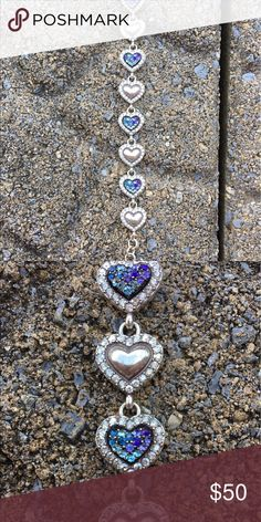 Brighton Heart Link Multi Color Bracelet Alternating ridged and brushed silver hearts with Swarovski crystals lining the heart and aqua, blue, and purple Swarovski crystal hearts with silver Swarovski crystals lining the hearts. Beautiful piece and brand new condition! Brighton Jewelry Bracelets