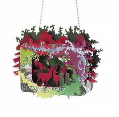 Oh My Deer ~Anna Talbot  Materials: Cookie box, anodized aluminium, wood, lacquer, silver and silk ribbon  Dimensions: 15cm x 11cm x 7cm  Necklace made from ready made cookie box with children and reindeer in a multicolored forest