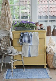 I would love to style the dresser in my kitchen like this.