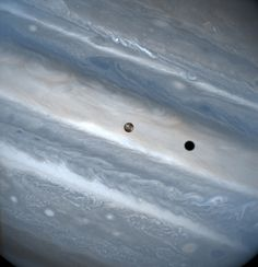 Jupiter's moon Io and its tiny shadow sweep across the giant planet's face back in as snapped by the Hubble Space Telescope. Credit: John Spencer (Lowell Observatory) and NASA Sistema Solar, Hubble Pictures, Hubble Images, Cosmos, Hubble Space Telescope, Space And Astronomy, Telescope Images, Astronomy Science, Space Planets