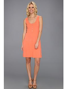 Classic tank dress is fabricated from ultrasoft combed cotton. Five-button placket at deep scoop neckline. Straight hem. Slip-on design. 100% cotton; Trim: 100% Supima® cotton. Machine wash cold, tumble dry low. Made in the U.S.A. and Imported. Measurements:      Length: 36 in  Product measurements were taken using size XS (US 0-2).