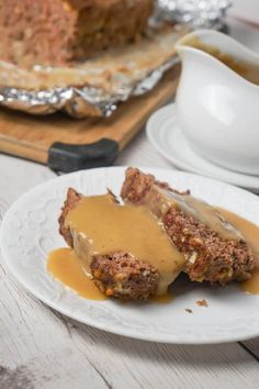 Meatloaf with Gravy is an easy 2 pound ground beef meatloaf recipe made with Stove Top stuffing mix and served with homemade gravy. Meatloaf With Oatmeal, Meatloaf With Gravy, Meatloaf Topping, Meatloaf Muffins, Ground Beef Recipes Easy, Beef Recipes For Dinner, Family Recipes, Beef Meatloaf Recipes, Easy Meatloaf