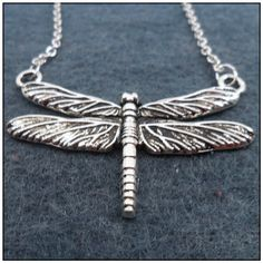 Dragonfly Necklace $17.50 Dragonflies symbolize strength, courage, happiness and moving past self-created illusions and so much more. I think I deserve this necklace.