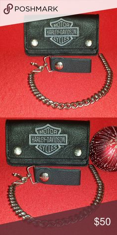 """Harley Davidson Biker's Wallet """"Harley Davidson Embroidered Biker's Wallet, has a 19"""" inch chain to secure it while you ride.   Made of black peddled high-quality Genuine leather with a classic gray Bar & Shield logo neatly embroidered on front. Features two shiny nickel snap closures. Carry a 19"""""""" shiny nickel biker chain with a leather belt leash. Biker chain keeps your wallet handy and secure. Size: 6"""""""" L x 3.5"""""""" H.   """" Harley-Davidson Bags Wallets"""