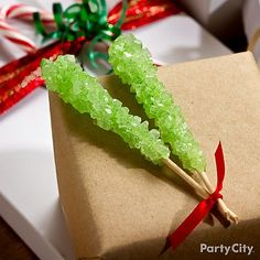 Decorate your Christmas presents with a couple rock candy sticks! It's easy and eye-catching - click the pic for more awesome DIY gift wrap ideas.