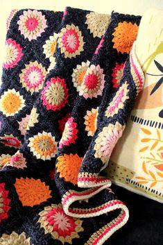 A Sunburst granny in great colors. German pattern here http://www.kasa-amend.com/2010/01/anleitung-sunburst-flower-granny-square-haekeln/  English pattern here http://www.scribd.com/doc/2518003/Flower-Granny-Square-Doc thanks so! xox