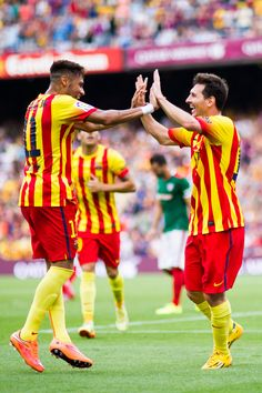 Neymar Santos Jr (L) of FC Barcelona celebrates with his teammate Lionel Messi (R) after scoring his second team's goal during the La Liga match between FC Barcelona and Athletic Club at Camp Nou on September 13, 2014 in Barcelona, Catalonia.