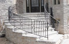 An ornamental curved metal railing installed and fabricated for a home in Hinsdale, IL.