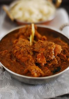 Traditional Kerala Chicken Curry cooked in a roasted coconut gravy.
