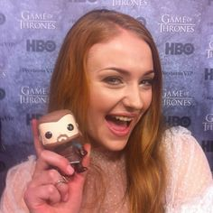 Sophie Turner, Game of Thrones Sansa Stark, is looking excited that her father Ned Stark's Funko POP comes with head still attached. Sophie Turner, Acteurs Game Of Throne, Game Of Thrones Instagram, Game Of Thrones Sansa, Game Of Thrones Merchandise, Game Of Throne Actors, Funko Pop Toys, Jamie Campbell Bower, Pop Television