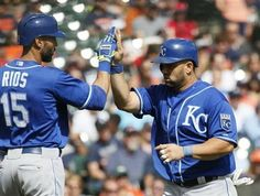 Kansas City Royals' Kendrys Morales is congratulated by Alex Rios (15) after hitting a home run against the Detroit Tigers during the third inning of a baseball game at Comerica Park Sunday, Sept. 20, 2015, in Detroit. (AP Photo/Duane Burleson)