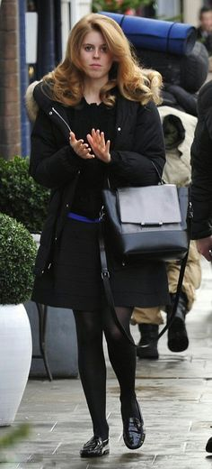 Princess Beatrice was spotted emerging from a South Kensington hair salon, hours before being driven to Buckingham Palace for the royal family's annual pre-Christmas lunch 2014