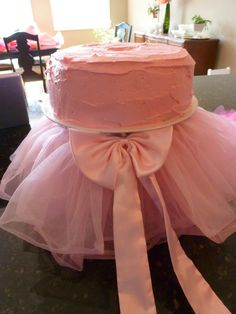 DIY Tutu cake... so stinkin' easy using an upside down pot to put the cake on top of and double sided tape to connect the tutu skirt to it... Yipee!
