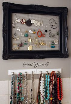 Need storage space? Tired of digging through jewelry boxes or cluttering up the top of your dresser? Easy DIY jewelry storage area and the best part, you can make these for under $10. Hunt flea markets garage sales for old frames and knobs (or hooks for the necklace bar). Use old fabric from an existing piece or buy new (lace works best given the holes throughout).