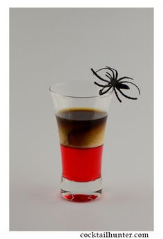 The Black Widow shot is a very easy shot to make, and the black sambuca tops this eerie little drink nicely. This is one of those recipes in which the color of the liqueur is key. We used black sambuc sambuca drinks Drinks Alcohol Recipes, Yummy Drinks, Alcoholic Drinks, Drink Recipes, Beverages, Halloween Drinks, Holiday Drinks, Halloween Foods, Halloween Ideas