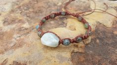 Check out this item in my Etsy shop https://www.etsy.com/listing/260563133/hemp-bracelet-aquamarine-labradorite