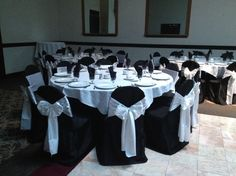 Black chair covers with white sashes and white table linens but add black chargers!