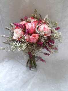 The wild flower look seen here includes roses, varied colours of heather and gypsophila. Herbs are a lovely accessory in the bouquets and can also be used in a wedding door wreath, pew ends and table arrangements. We at Shirleys Blooms have a wide variety of bouquets to choose from.