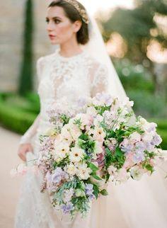 Overflowing lilac hued bouquet http://www.stylemepretty.com/2016/02/29/dreamy-lilac-blush-wedding-inspiration/ | Photography: Jose Villa - http://josevillablog.com/: