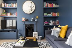 Dark blue walls by Farrow & Ball, lifted with yellow velvet cushions and alcove . - Dark blue walls by Farrow & Ball, lifted with yellow velvet cushions and alcove shelving housing a - Dark Blue Living Room, Living Room Grey, Living Room Interior, Home Living Room, Dark Blue Lounge, Farrow And Ball Living Room, Bright Living Room Decor, Duck Egg Blue And Yellow Living Room, London Living Room