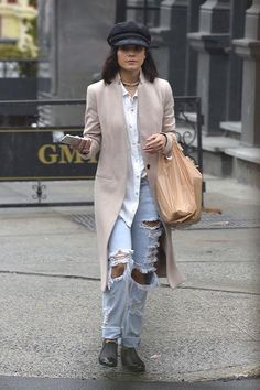 Vanessa Hudgens in ripped boyfriend jeans, a white shirt, and newsboy cap in NYC