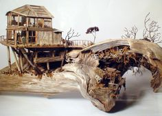 Seascapes made with driftwood and other beach finds by sculptor Neal Personeus, Cape Cod, MA.