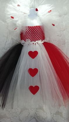 This Tutu Costume is sure to dazzle. This dress is made with a crochet top, and yards and yards of red, black, and white tulle, with a ruffle
