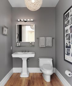 powder room with steel gray walls and white twine pendant over oak hardwood floors - www.insterior.com
