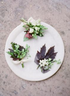 I like the incorporation of fall leaves, though more on the reddish/burgundy side would be better. Maybe blush florals and deep teal ribbon. -DS textural boutonnieres by Sarah Winward