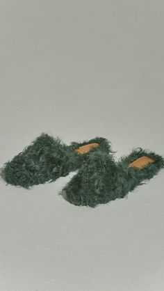 Études Furry Slide in Hunter Green Shearling. Shearling mule, created entirely with curly lambs wool. Slide loafers with a round square toe, padded leather foot bed and rubber soles. Slip on. This ite